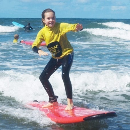 kid learning to surf