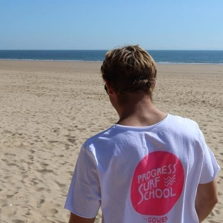 Rhys on beach in hot pink long T dress back print